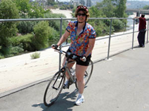 Laurie riding by the LA River on bike path