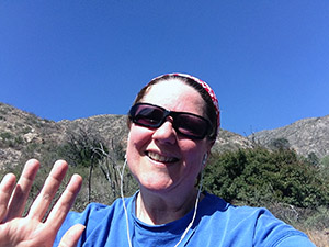 Laurie waves good-bye from the mountain